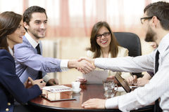 Sealing a Deal. Business group sealing a deal at office Royalty Free Stock Photos