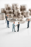 Sealing a Deal. Businessmen making a deal or taking bribes for a big pile of cash shot with selective focus Royalty Free Stock Photography