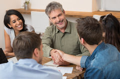 Sealing a deal with shaking hands Stock Photo