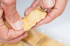 Sealing and decorating raw cut ravioli edge. Ravioli Preparation : Sealing and decorating raw cut ravioli edge Royalty Free Stock Photos