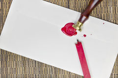 Sealing an envelope with wax. Royalty Free Stock Photography