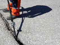 Sealing joint. Crack in asphalt or concrete surface Stock Image