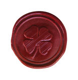 The sealing wax press. Saint patrick's shamrock wax seal used to sign and close letters Stock Photography