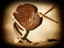 Sealing wax stamp. Old sealing wax stamp in a spot of light Stock Images