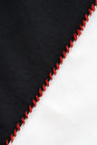 Seam. Closeup of black and white textile material jointed by red thread seam royalty free stock photo