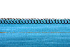 Seam. Macro of a seam in blue woven fabric royalty free stock image