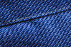 Seam. Macro of a seam in blue woven fabric Royalty Free Stock Photography