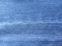 Seam on blue color jeans.  stock photo