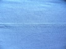 Seam of blue cotton cloth. Seam of blue color cotton cloth royalty free stock images