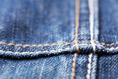 Seam on blue jeans Stock Photos