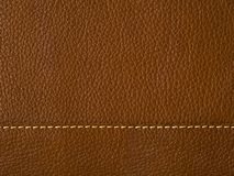 Seam on brown leather. Close Up straight seam on surface of natural brown leather stock photography