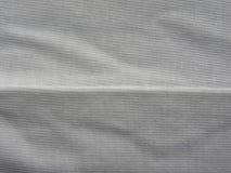 Seam on gray cloth. Seam on gray color cotton cloth stock photo