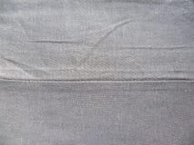 Seam of gray cotton cloth. Seam of gray color cotton cloth royalty free stock photos
