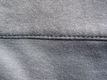 Seam on gray color fabric.  royalty free stock image