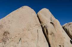 Seam of Rock in Sandstone with Deep Blue Sky Royalty Free Stock Photography