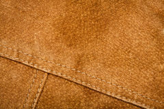 Seam on suede product. Scratched worn suede texture with seam stock photo