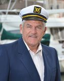 Seaman Captain. Maritime sailor with a captain's hat at the marina Stock Photography