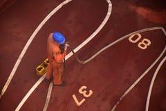 Seaman checking fire hoses royalty free stock image