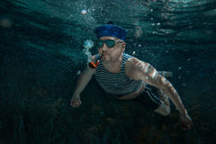 Seaman swims under water. Royalty Free Stock Photos