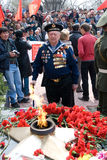 Seaman veteran. ULAN-UDE, RUSSIA - MAY 9: An elder seaman veteran looks with sorrow at eternal flame on annual Victory Day, May, 9, 2009 in Ulan-Ude, Buryatia Royalty Free Stock Images