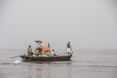 Seamen on their boat. Three seamen are driving their boat out to the fishing grounds at  Myeik in the south of Myanmar Stock Photos
