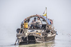 Seamen on their boat. Two seamen are driving their boat out to the fishing grounds at  Myeik in the south of Myanmar Stock Photos