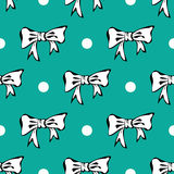 Seamles pattern background with white bows and pol. Cute seamless  pattern background  wallpapers with white bows and polka dots vector Stock Image