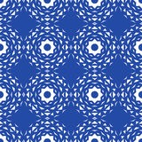 Seamless abstract background with white geometrical shapes. Blue background. The contrast image Stock Image