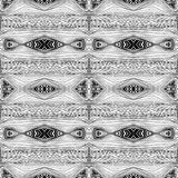 Seamless abstract black and white kaleidoscopic pattern. Wavy hand drawn endless geometric texture Stock Photography