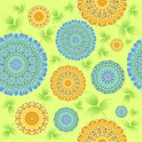 Seamless abstract blossoms yellow and blue with green leaves on light green Stock Photography