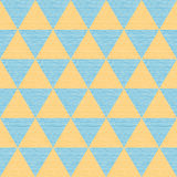 Seamless abstract blue and orange triangles. Colored wooden board Stock Images