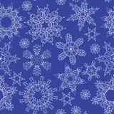 Seamless abstract dark blue pattern with snowflakes Royalty Free Stock Photos