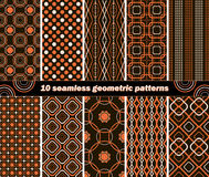 10 seamless abstract geometric contrasting patterns. Set of 10 different abstract geometric contrasting patterns in black, white and orange colors. Vector royalty free illustration