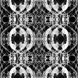 Seamless abstract graphic pattern. Seamless abstract kaleidoscope pattern. Hand drawn curly shapes, wavy layout slightly shifted, white outlines on black Stock Photography