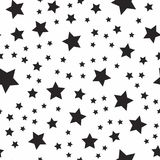 Seamless abstract pattern with black stars of different size on white background. Vector illustration Royalty Free Stock Images