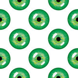 Seamless abstract  pattern, bright symmetrical background with close-up green pupils of the eyes over white backdrop Royalty Free Stock Photography
