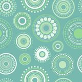 Seamless abstract pattern of circles and dots of green and turquoise colors. Kaleidoscope background. Decorative wallpaper, good for printing. Vector stock illustration