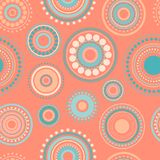 Seamless abstract pattern of circles and dots of orange and turquoise colors. Kaleidoscope background. Decorative wallpaper, good for printing. Vector royalty free illustration