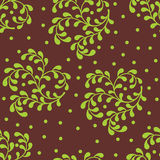Seamless abstract pattern.green sprigs on a brown background Stock Image