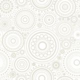 Seamless abstract pattern of grey circles and dots on white background. Kaleidoscope background. Stock Photos