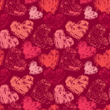 Seamless abstract pattern with grunge colorful hearts on red bac Stock Photos