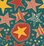 Seamless abstract pattern with stars. Starry decorative drawn background Royalty Free Stock Images