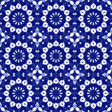 Seamless abstract round white blossoms on dark blue Stock Photography