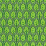 Seamless abstract vector pattern.leaves tile in green background royalty free stock photo