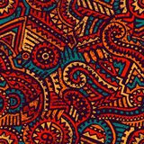 Seamless african pattern. Ethnic and tribal motifs. Orange, red, yellow, blue and black colors. Grunge texture. Vintage print for