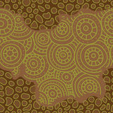 Seamless african pattern. Sketch circular ornaments. Brown and green color Royalty Free Stock Photography