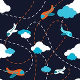 Seamless airplane pattern. Aircraft in clouds. Cartoons style. Colorful plane on dark background. Kids boy plane pattern Stock Photography