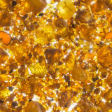 Seamless Amber Texture in Backlit. Seamless amber stones texture in back light and a soft glow between them Stock Photo