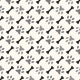 Seamless animal pattern of paw footprint and bone Royalty Free Stock Photo