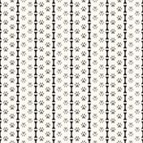 Seamless animal pattern of paw footprint and bone Royalty Free Stock Photos